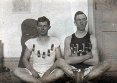 Lee-Ream-right-with-track-medals-abt-1910